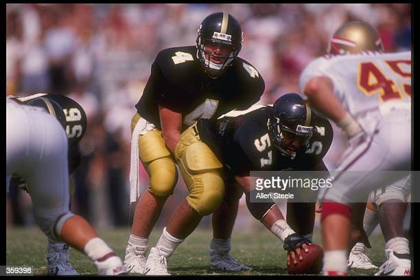 Quarterback Brett Favre of the Southern Mississippi Golden Eagles calls the snap count from under center during the Golden Eagles 3026 victory over...