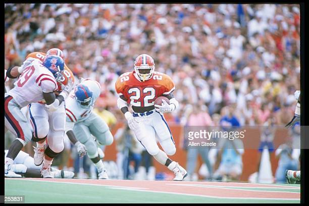 Running back Emmitt Smith of the Florida Gators runs down the field during a game against the Mississippi Rebels at Florida Field in Gainesville...