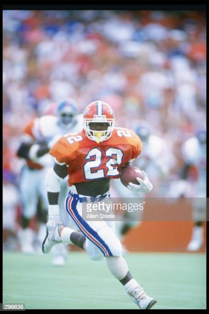 Running back Emmitt Smith of the Florida Gators runs down the field during a game against the Mississippi Rebels at Florida Field in Gainesville,...