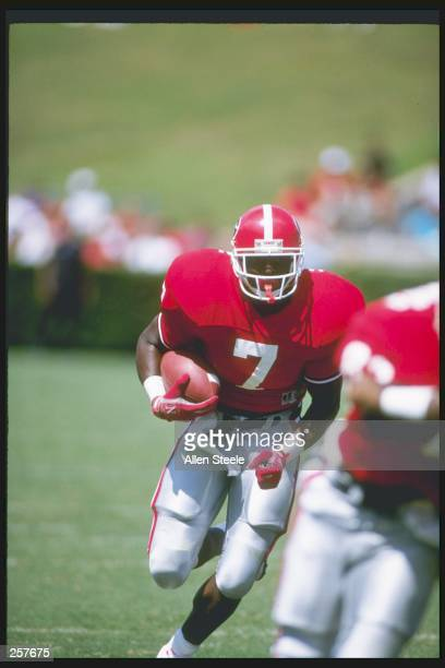 Running back Rodney Hampton of the Georgia Bulldogs runs down the field during a game against the Baylor Bears at Sanford Stadium in Athens, Georgia....