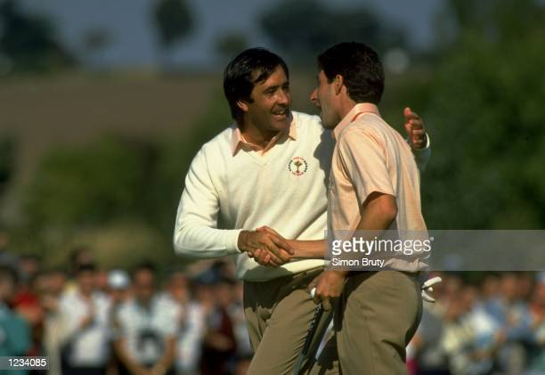 Seve Ballesteros and Jose Maria Olazabal of the European team shake hands during the Ryder Cup at the Belfry in Sutton Coldfield England Mandatory...