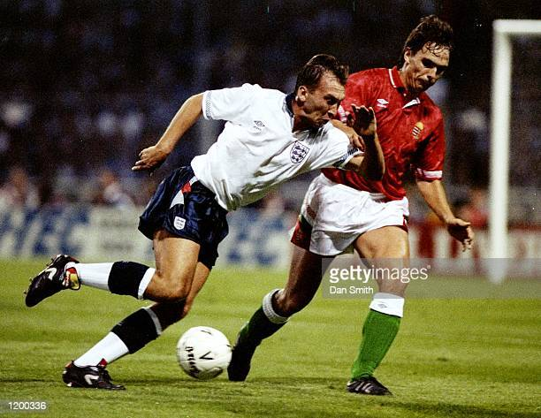 David Platt of England is shadowed by Jozsef Keller of Hungary during a Friendly match at Wembley Stadium in London England won the match 10...