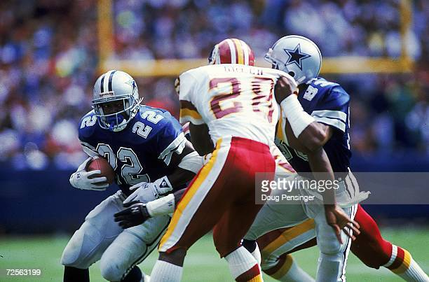 Emmitt Smith of the Dallas Cowboys carries the ball during a game against the Washington Redskins The Redskins defeated the Cowboys 1915 Mandatory...