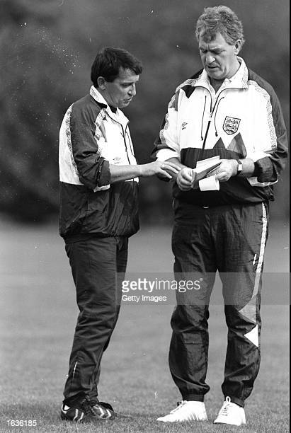 England manager Graham Taylor discusses tactics with his assistant Lawrie McMenemy on the training pitch at Bisham Abbey in England. \ Mandatory...