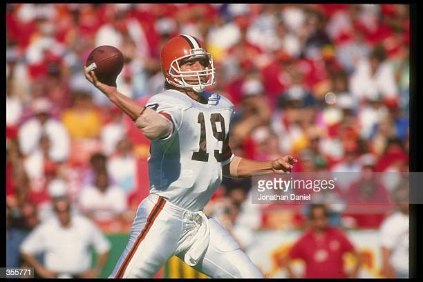 Quarterback Bernie Kosar of the Cleveland Browns passes the ball during a game against the Kansas City Chiefs at Cleveland Stadium in Cleveland Ohio...