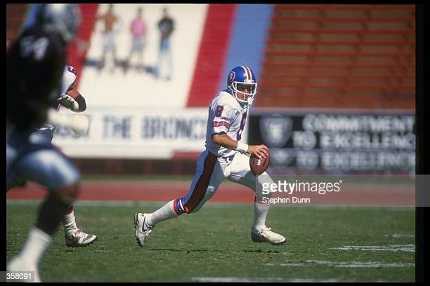 Quarterback Gary Kubiak of the Denver Broncos runs with the ball during a game against the Los Angeles Raiders at the Coliseum in Los Angeles...