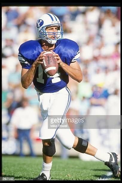Quarterback Ty Detmer of the Brigham Young Cougars drops back to pass during a game against the San Diego State Aztecs at Cougar Stadium in Provo,...