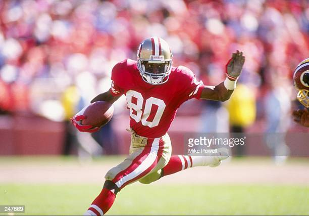 Wide receiver Jerry Rice of the San Francisco 49ers runs down the field during a game against the Washington Redskins at Candlestick Park in San...