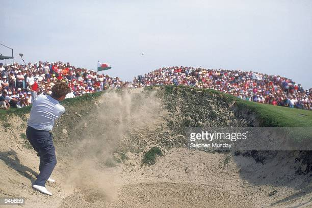 Ian Woosnam of the European team plays out of the bunker on the 17th hole during the Final Day Singles of the Ryder Cup at Kiawah Island in South...