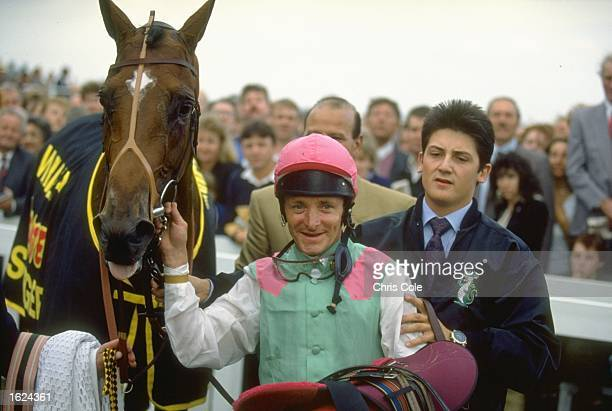 Pat Eddery of Ireland stands with Toulon in the winners enclosure after winning the St. Leger at Doncaster racecourse in Doncaster, England. \...