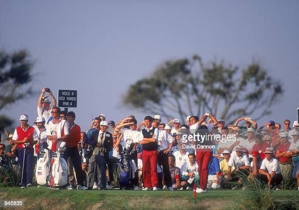 Seve Ballesteros tees off on the 4th hole watched by European team partner Jose Maria Olazabal and USA team pairing Paul Azinger and Chip Beck on Day...