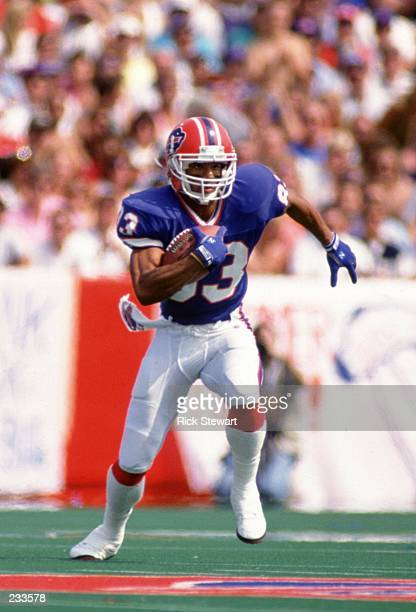 Wide Receiver Andre Reed carries the football after making a catch during the Bills 5234 win over the Pittsburgh Steelers at Rich Stadium in Orchard...