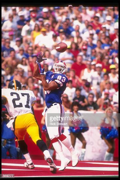 Wide receiver Andre Reed of the Buffalo Bills catches the ball during a game against the Pittsburgh Steelers at Rich Stadium in Orchard Park New York...