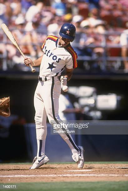 Andujar Cedeno of the Houston Astros is hit by a pitch during a game against the San Diego Padres at Jack Murphy Stadium in San Diego California