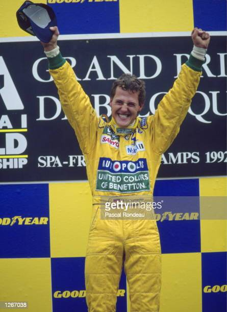 Benetton Ford driver Michael Schumacher of Germany holds his arms aloft as he stands on the winners'' podium after the Belgian Grand Prix at the Spa...