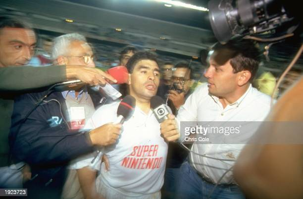 Diego Maradona of Seville is surrounded by the press after his return match against Bayern Munich. Seville won the match 3-1. \ Mandatory Credit:...