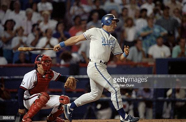 George Brett of the Kansas City Royals swings as he make the 3000th hit of his career during the game against the California Angles at Anaheim...