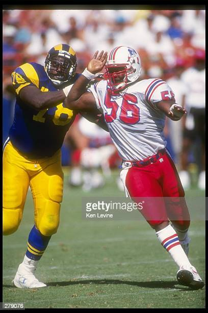 Linebacker Andre Tippett of the New England Patriots works against Los Angeles Rams offensive lineman Jackie Slater during a game at Anaheim Stadium...