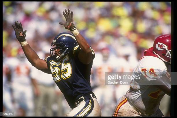 Linebacker Junior Seau of the San Diego Chargers rushes the Kansas City Chiefs quarterback during a game at Jack Murphy Stadium in San Diego...