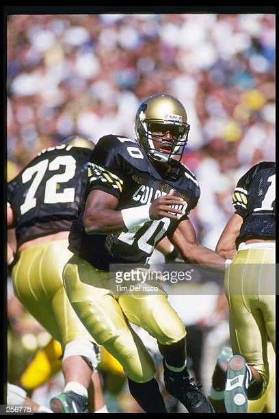 Quarterback Kordell Stewart of the Colorado Buffaloes hands off the ball during a game against the Iowa Hawkeyes at Folsom Field in Boulder, Colorado.