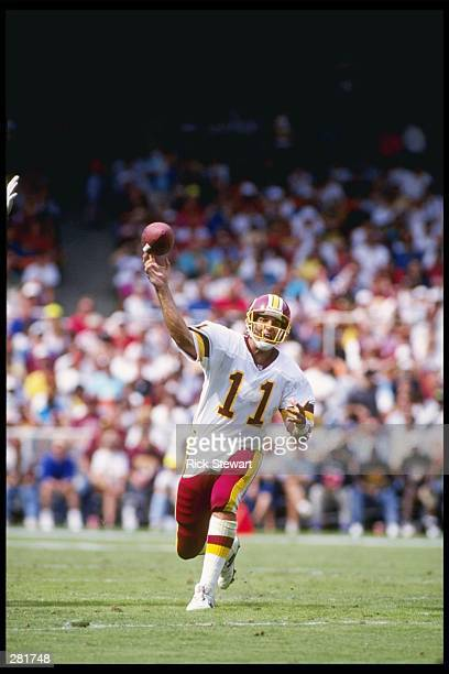 Quarterback Mark Rypien of the Washington Redskins passes the ball during a game against the Atlanta Falcons at RFK Stadium in Washington, D. C. The...