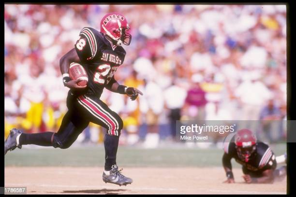 Running back Marshall Faulk of the San Diego State Aztecs runs down the field during a game against the USC Trojans at Jack Murphy Stadium in San...