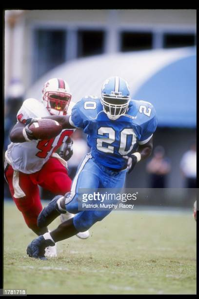 Running back Natrone Means of the North Carolina Tar Heels runs with the ball during a game against the North Carolina State Wolfpack at Kenan...