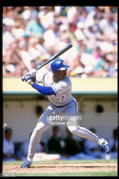 Devon White of the Toronto Blue Jays swings at the ball during a game against the Oakland Athletics at the Oakland Coliseum in Oakland Califoria...