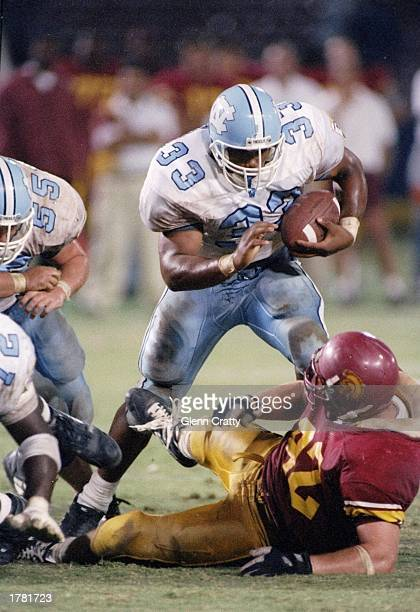 Fullback William Henderson of the North Carolina Tar Heels runs with the ball during the Pigskin Classic game against the USC Trojans North Carolina...