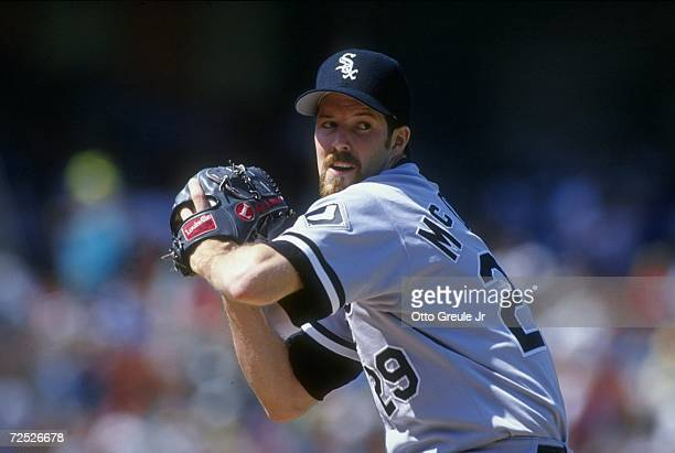 Pitcher Jack McDowell of the Chicago White Sox in his wind up during a game against the Oakland Athletics at the Oakland Coliseum in Oakland,...