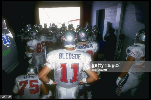 Quarterback Drew Bledsoe of the New England Patriots prepares to get onto the field for a game against the Buffalo Bills at Rich Stadium in Orchard...