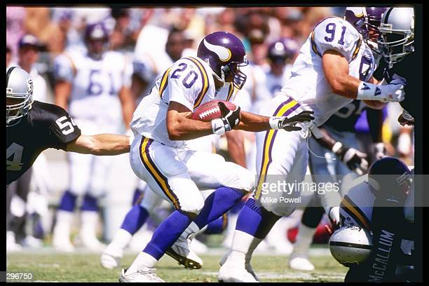 Running back Robert Smith of the Minnesota Vikings moves the ball during a game against the Los Angeles Raiders at the Los Angeles Memorial Coliseum...