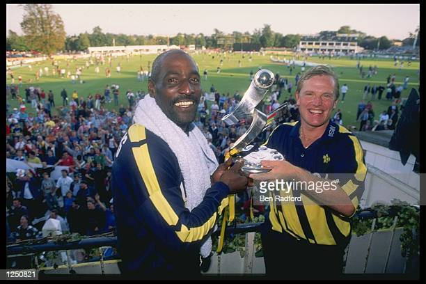 Viv Richards of the West Indies with Hugh Morris of England celebrate with the trophy after the A.E.L.L match between Kent and Glamorgan at...