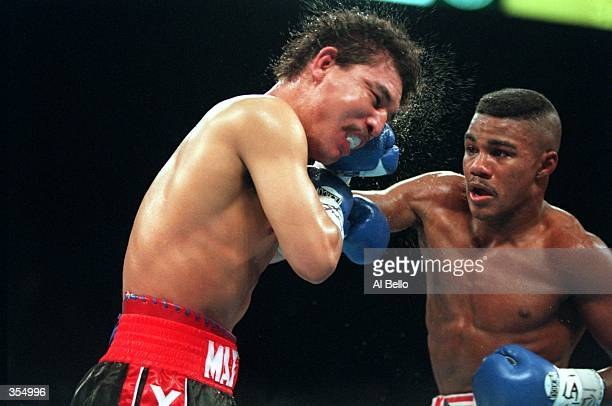 FELIX TRINIDAD CONNECTS WITH A PUNCH TO LOUIS YORI BOY CAMPAS BEFORE A 4TH ROUND TKO IN AN IBF WELTERWEIGHT CHAMPIONSHIP FIGHT AT THE MGM GRAND HOTEL...