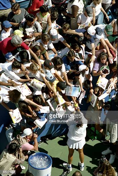 Gabriela Sabatini of Argentina signs autographs for her fans during the US Open at Flushing Meadow in New York USA Mandatory Credit Clive...