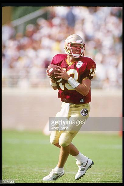 Quarterback Danny Kanell of the Florida State Seminoles drops back to pass during a game against the Virginia Cavaliers at the Doak S Campbell...