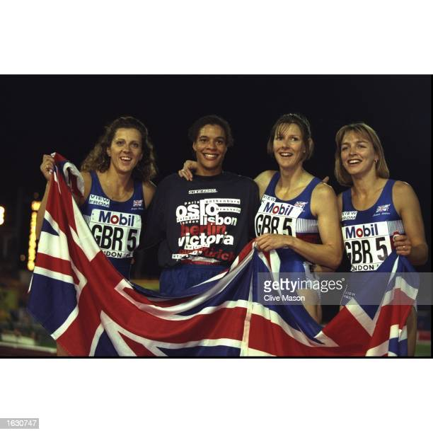 Sally Gunnell Phylis Smith Linda Keough and Melanie Neef of Great Britain celebrate with the Union Jack after winning the 4 x 400 metres Relay event...