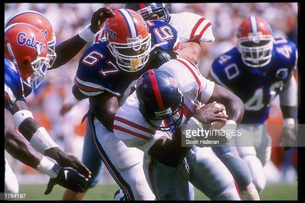 Defensive lineman Mark Campbell of the Florida Gators tackles running back Mark Smith of the Mississippi Rebels during a game at Florida Field in...