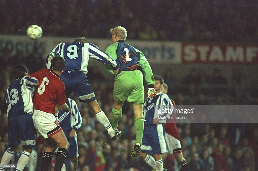 Peter Schmeichel #1 of Manchester United heads in a goal during the UEFA Cup first round second leg match against Rotor Volgograd at Old Trafford in Manchester, England. The match was drawn 2-2. \ Mandatory Credit: Mark Thompson /Allsport
