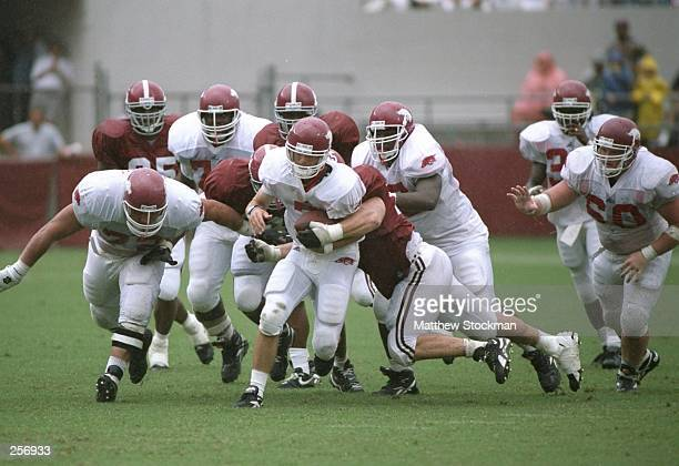Quarterback Barry Lunney of the Arkansas Razorbacks runs down the field during a game against the Alabama Crimson Tide at Bryant-Denny Stadium in...