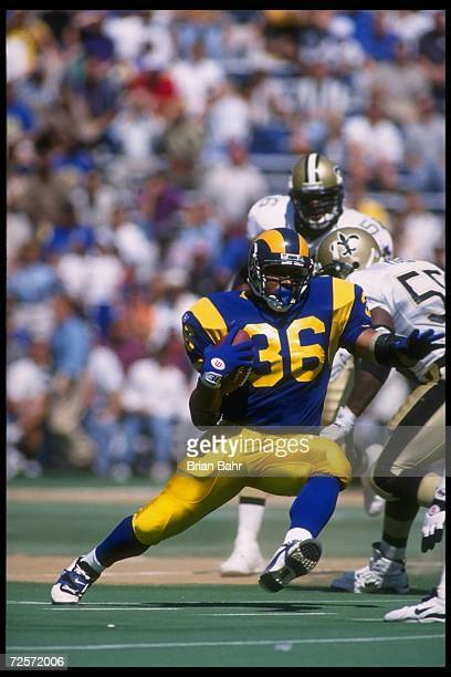 Running back Jerome Bettis of the St. Louis Rams runs against the New Orleans Saints during a game played at Busch Stadium in St. Louis, Missouri,...