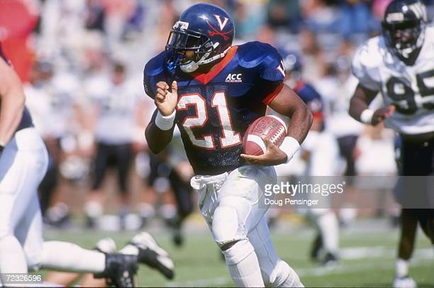 Running back Tiki Barber of the Virginia Cavaliers looks up field as he makes a cut to the outside during a carry in the Cavaliers 35-17 victory over...
