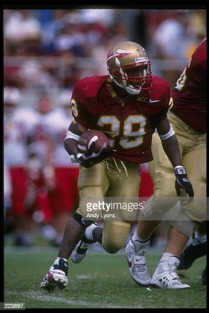 Running back Warrick Dunn of the Florida State Seminoles moves down the field during a game against the North Carolina State Wolfpack at CarterFinley...
