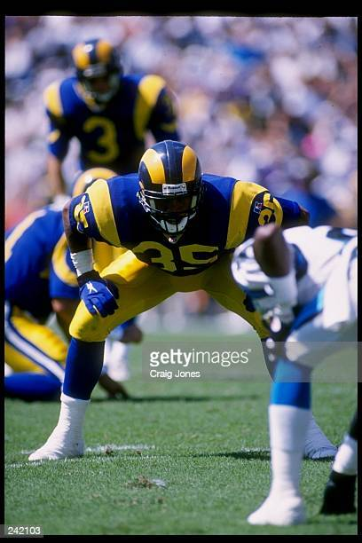 Safety Keith Lyle of the Los Angeles Rams stands on the field during a game against the Carolina Panthers at Memorial Stadium in Clemson, South...