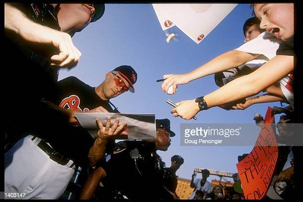 Shortstop Cal Ripken of the Baltimore Orioles signs autographs after a game against the California Angels at Camden Yards in Baltimore, Maryland...