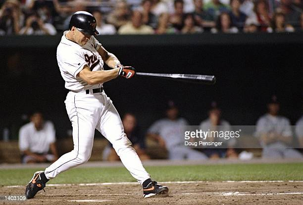Shortstop Cal Ripken of the Baltimore Orioles swings at the ball in a game against the California Angels at Camden Yards in Baltimore Maryland during...