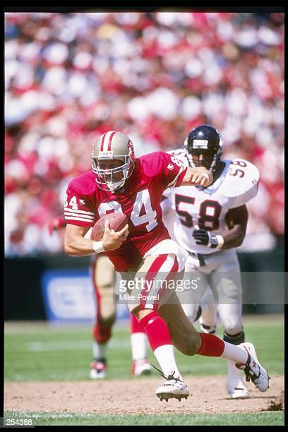 Tight end Brent Jones of the San Francisco 49ers moves the ball during a game against the Atlanta Falcons during a game at 3Com Park in San...