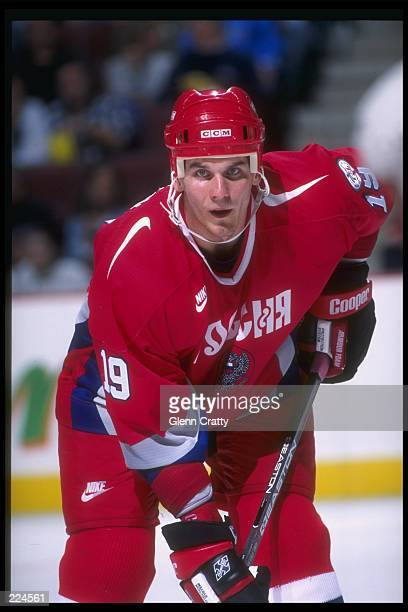 Alexei Yashin of Russia looks on during a World Cup game against the United States at the Corel Center in Ottawa Ontario USA won the game 52...