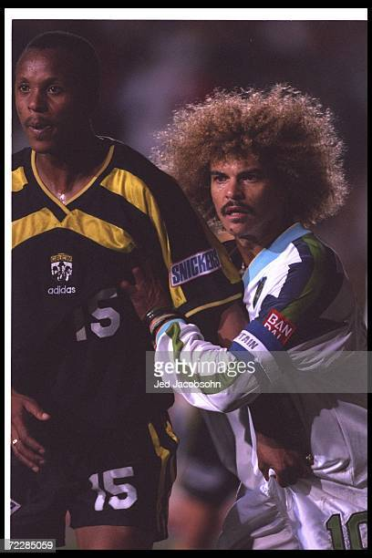 Carlos Valderrama of the Tampa Bay Mutiny and Doctor Khumalo of the Columbus Crew look on during a game at Ohio Stadium in Columbus Ohio The Mutiny...
