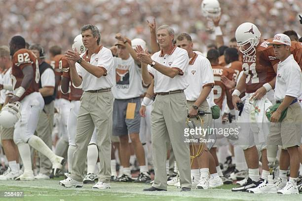 Coach John Mackovic of the Texas Longhorns watches his players during a game against the Notre Dame Fighting Irish at Texas Memorial Stadium in...